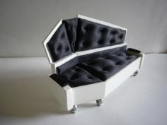 Awesome freaking couch. I would love to have one of these Coffin couches.