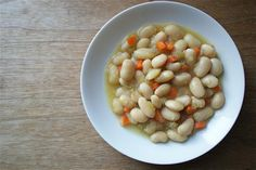 How to cook dried beans (i.e. navy beans, pinto beans, black beans, or cannellini beans) perfectly every time with these easy steps.