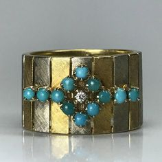 This is a gorgeous 1970s diamond and light blue turquoise ring. The stones are placed in a flower pattern and set in a 14k white and yellow gold art nouveau setting. Turquoise FYI - Turquoise is the birthstone for December Diamond FYI - April birthstone and tenth anniversary