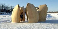 """Bent plywood wind shelters built in """"herds"""" or """"villages"""" in Winnipeg, by Patkau Architects"""