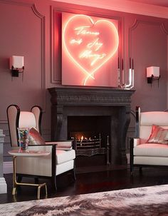 The artwork above the fireplace is a Tracey Emin original and was a wedding present from Tamara's younger sister Petra Stunt