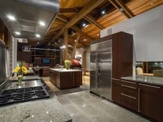 http://iss.zillowstatic.com/image/contemporary-kitchen-with-exposed-beams-accent-wall-and-wood-ceiling-i_g-IS-1gl2cgft0db31-sKOPZ.jpg