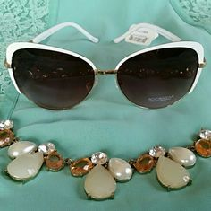 Rocawear Sunglasses Sunglasses with gold trim, white earpieces and white detailing above frames. Perfect condition, no chipping or discoloration. Rocawear Accessories Sunglasses