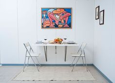 Get a table that folds into the wall, like a murphy bed.