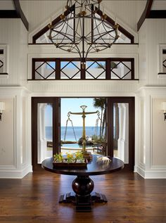 Foyer. This is one of the best foyer design I have seen! Love the ocean view, the architecture details and decor. #Foyer #Interiors