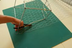 Cover the lampshade frame with chicken wire for a DIY lampshade.