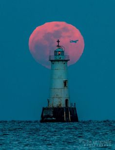 February 10, 2017 Full Moon while a penumbral eclipse is taking place behind Great Beds Lighthouse in Raritan Bay, New Jersey. Photo by John Entwistle. | EarthSky