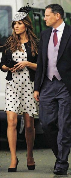 Kate in polka dot Topshop dress with a black Ralph Lauren jacket and a Vivien Sheriff black and white Feathered Fascinator with Annoushka Pearl Earrings