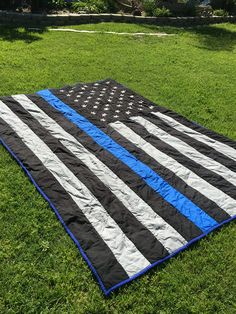 Blue lives matter quilt I made from my son. Could not find a pattern so I can up with one. The stars are embroidered .