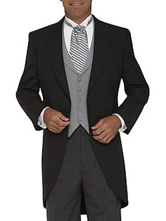 Men's Wearhouse Joseph Feiss One-Button Gray Peak Lapel Cutaway A satin-faced peak lapel enhances the refined style of this gray, cutaway tuxedo. Coordinating gray stripe pleated pants complete this romantic look. Tuxedo Wedding, Wedding Suits, Wedding Attire, Wedding Gowns, Cutaway, Groom Morning Suits, Father Of The Bride Outfit, Tuxedo With Tails, Morning Dress