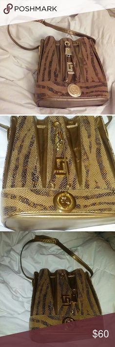 Paul Joseph Vintage Gold Leather Reptile Bag The color is hard to describe and capture. Its an incredible gold snakeskin like 28th an irridescence. The hardware and decorative medalion are bright gold tone. It is like New condition. I can find no flaws, marks, or stains anywhere. Bags Satchels