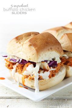 Spicy buffalo chicken cooked in a slow cooker, top with slaw, and served on a fluffy slider bun! An easy and delicious dinner or appetizer with only 5 ingredients! * Made September Yummy. Spicy Recipes, Slow Cooker Recipes, Crockpot Recipes, Chicken Recipes, Cooking Recipes, Easy Recipes, Chicken Subs, Pesto Chicken, Chicken Meals