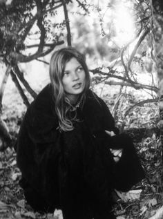Kate Moss in the woods // black coat