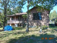 Sweet newer home nestled on the upper side of this 20 acre m/l property outside the city limits. 3 Bedroom, 2 Bath Home was built in 2012. Large open living room with modern kitchen. The property is fenced and cross fenced and ready for a few cattle. (currently has cattle on property) There are a couple of ponds on property and there is a shared well agreement. Property is located conveniently outside Berryville or Green Forest and close to highway to bigger towns and cities in Berryville AR