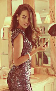 I want to look like this on my birthday. Or New Year's Eve before a huge party. Sequined/sparkly dresses are immensely appealing, aren't they?
