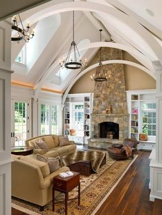 Living room: gorgeous vaulted ceiling, fireplace and windows.