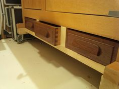 Repurposed drawers to fit at the bottom of my workbench for storage