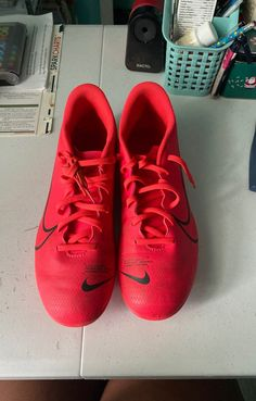 Nike soccer cleats that i have worn maybe 3 time(cause or Covid) they are an orangey red color! Let me know if you have any offers!
