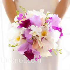 Megan carried an exotic fuchsia and white bouquet of mainly orchids.