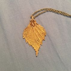 Real Gold Leaf Necklace I bought this in Saint Augustine a few years ago and cannot wear it since I found out I am allergic to gold. This was an actual leaf that was hand dipped in gold. It is unique and truly shows how beautiful and intricate Mother Nature is!!! Great with any outfit(: **listed as brand for exposure only Sunahara Jewelry Jewelry Necklaces