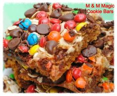 M & M Magic Cookie Bars..So delicious..Go to cookiescrumbsandchickens.blogspot.com for recipe