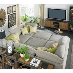I like the U shaped sectional although I don't think  I need all those extra ottomans!