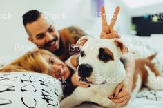 http://media.istockphoto.com/photos/hipster-couple-waking-up-with-their-dog-picture-id501391238