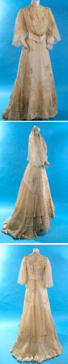Embroidered net wedding gown, G.C. Clark, ca. 1890. Lace appliqué on net overlay. Front-closing bodice with hooks & eyes in stayed lining, bell-shaped overlay sleeves with chiffon undersleeves and snug lace-trimmed cuffs. Satin sash. Hook & eye back-closing skirt, lined in silk taffeta with layer of fine white tissue chiffon between lining and net/lace exterior. Tiered layers of appliqué lace at base of skirt with train at back. Carolyn Forbes Textiles