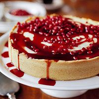 Pomegranate cheesecake--a bit of brown sugar added to pomegranate juice and cooked until thickened creates a vivid scarlet sauce to drizzle on this creamy dessert.