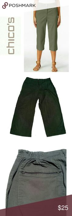 "CHICO'S DARK GREEN CROP PANTS Sz 2 CHICO'S DARK GREEN CROP PANTS Pre-loved / photo only for similarity  BEAUTIFUL STYLE AND CASUAL COMFORTABLE! *.  2 Elongated Patch Front Pockets w/Side Entry  *.  2 Back Zippered Pockets *.  Fly Zipper Front w/Button *.  Partial Elastic Waist  *.  Small Bottom Legs Slit *.  Approx Measurements; W 16"" Inseam 23"" W 9"" This is Chicos SIZE 2! Chico's Pants Ankle & Cropped"
