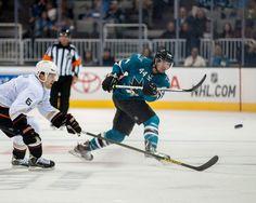 San Jose Sharks defenseman Marc-Edouard Vlasic clears the puck (Sept. 20, 2013).