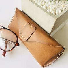 Hand stitched soft tan leather sunglasses case with magnetic snap closure button. Stitching Leather, Hand Stitching, Leather Bags, Tan Leather, Sunglasses Case, Buy And Sell, Stuff To Buy, Accessories, Leather Tote Handbags