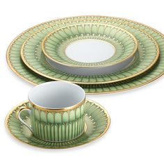 Bring an air of spring freshness to your table setting. Philippe Deshoulieres Arcades Dinnerware from the Limoges region in France has a bold and modern gold and green accent border that adds a touch of color to your tabletop. Dinnerware Sets, China Dinnerware, Pc Table, Motif Art Deco, Green China, Villeroy, Dish Sets, Dinner Sets, China Patterns