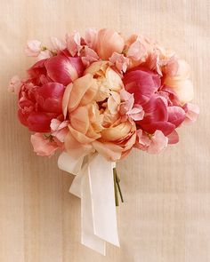 This simple bouquet is composed of giant, lush peonies and ruffly sweet peas in various shades of pink.