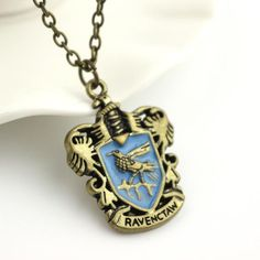 Get this Harry Potter Hogwarts House Crest Pendant Necklace and let the world know you're a Harry Potter fan! Perfect for any fandomer, wizard, or witch! Make a gift for yourself or your friend, every