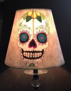This Sugar Skull lampshade would make a unique macabre piece to decorate your home all year around, placed in a window it eerily looks out on the world