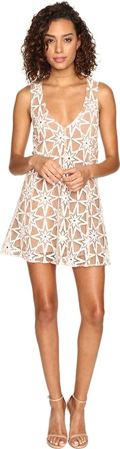 For Love and Lemons Women's Metz Mini Dress Latte Dress. Add a whimsical touch to your wardrobe with the Metz Mini Dress. Shift silhouette. Custom embroidered lace creates a floating stars illusion. Plunging V-neckline. Sleeveless. Contrast lining. Straight hemline. Slip-on. 71% cotton, 29% nylon;Lining: 97% polyester, 3% spandex. Dry clean only. Imported. Measurements: Length: 33 in Product measurements were taken using size SM. Please note that measurements may vary by size.