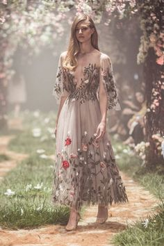 Paolo Sebastian               Tea-length tulle gown with floral embroidery and wing sleeves
