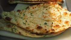 Naan is a traditional Indian-style flatbread recipe made in a clay oven (tandoor), but you can easily make at home using an oven or a cast-iron skillet, or on a tawa. Indian Potato Recipes, Indian Food Recipes, Vegan Recipes, Easy Recipes, Easy Naan Recipe, Roti Recipe, How To Make Dough, Food To Make, Easy Snacks