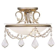 Add elegant appeal to your library or living room with this white alabaster glass semi-flush mount, featuring draped crystal bead accents.