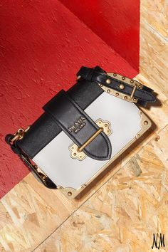 Complete your look with a hardware-detailed, colorblock shoulder bag by Prada. Perfect for all occasions from work to play.