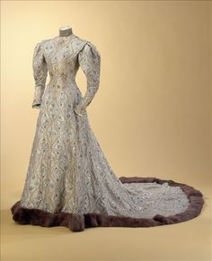"""""""Byzantine"""" dress by Charles Frederick Worth, c.1904 - Gold lamé silk taffeta, cream silk tulle entirely embroidered with beads, paillettes and gold metallic thread, fur trim and lining made of silk taffeta and silk satin.  Worn by Comtesse Greffuylhe to the wedding of her daughter, Elaine and Armand, Duc de Guiche, at the Eglise de la Madeleine in Paris on 5 November 1904"""