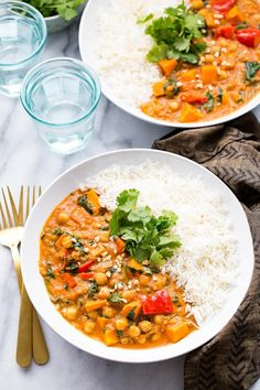 This Slow Cooker African-Inspired Peanut Stew is a hearty chickpea & sweet potato curry served with basmati rice. It's also gluten-free and vegan!