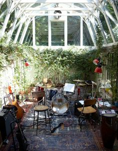 Green house music room. Not sure how safe this would be considering the humidity, but a space like this would be incredible
