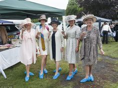 A group of ladies enjoy a well-earned glass of bubbly as they protect their feet - and heels. Royal Ascot Day One - 14 June 2016.