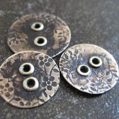Metal buttons made with riveted holes...cool.