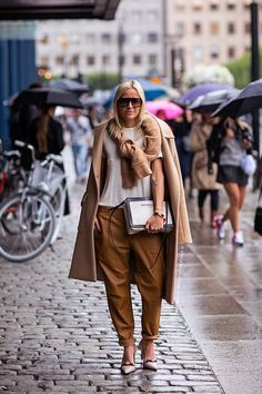 trending: the camel coat - camel-colored trousers worn with a white t-shirt and nude heels + matching camel sweater tied around the neck