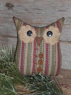 For your consideration is this handmade hoot owl. He has been created using a cotton fabric with a striped pattern. Lovely holiday colors of burgundy, green, beige, white and black throughout. I have meticulously machine stitched the owl and then stuffed him full with polyester fiberfill.
