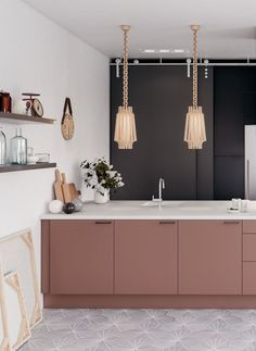 not the floors, wall accessories or lighting - but yes to cabinet colour and brass and dark wall.