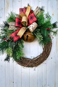 Rustic Christmas Wreath with Bell This rustic Christmas wreath will look great on your front door, over a mantel or anywhere in your home this holiday season. Made on a grapevine base, this Christmas wreath is filled with an assortment of pines and features a large rustic bell. The